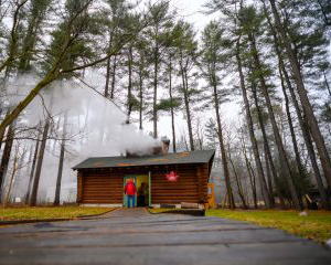 Steam pours from the vented ceiling of the Kellogg Forest sugar shack, also known as Maple Manor, during sugaring season.